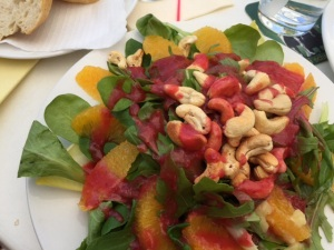 Inspired German Rucola Salad with Cashews, Oranges and Strawberry Vinaigrette, with glass of Franconian Riesling