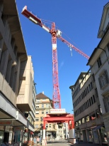 Cranes everywhere, except this one straddles the street