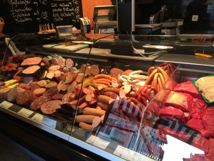 A fancy deli selling house-made sausages