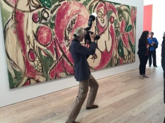 Photographer in front of Krasner piece