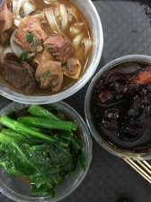 Pig's Feat and Braised Beisket of Beef on Noodles with Greens